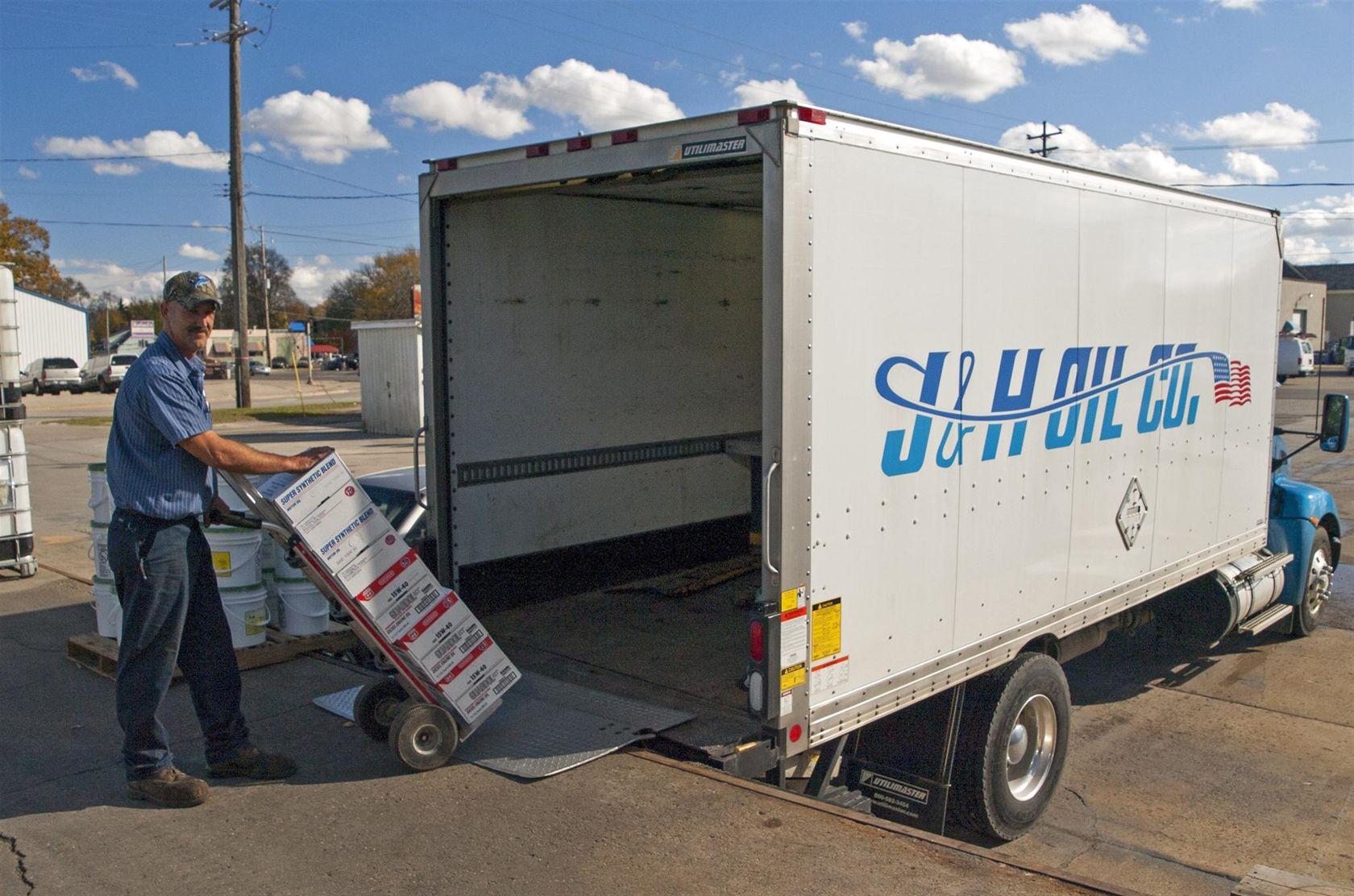 J & H Oil Co. Joe loading Lubricants